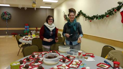 While they waited for more winners - Rachel and Eve jumped in and frosted our Birthday cupcakes and our gingerbread cookies. Great job ladies - and thank you for all that you do!